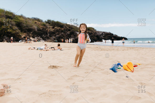 Little girl running in the sand in Hawaii