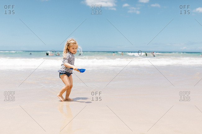 Little girl playing in the water in Hawaii