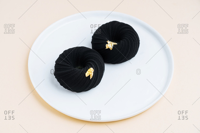 Two black cake donuts
