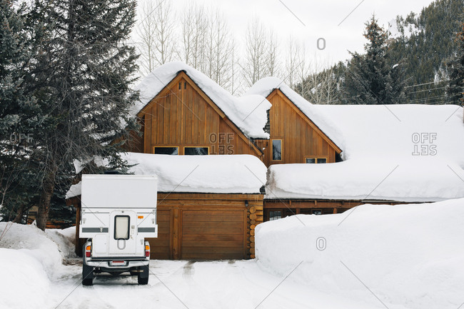 Snow covered house and car in Sun Valley, Idaho