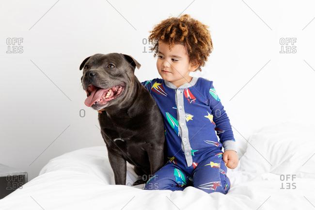 Boy sits with dog