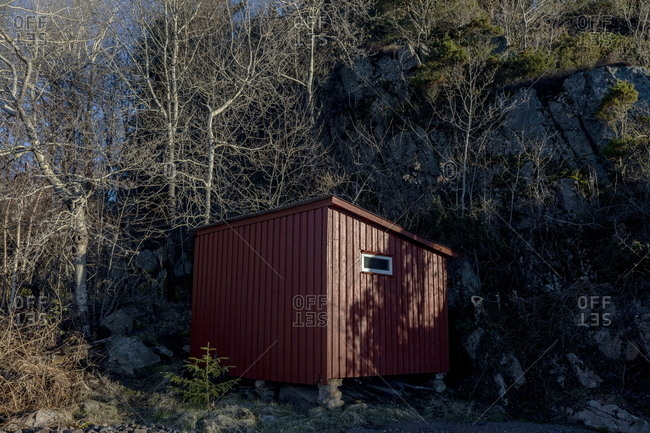 Small red building in rural Norway