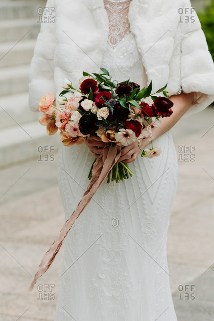 Portrait of a bride holding rose bouquet