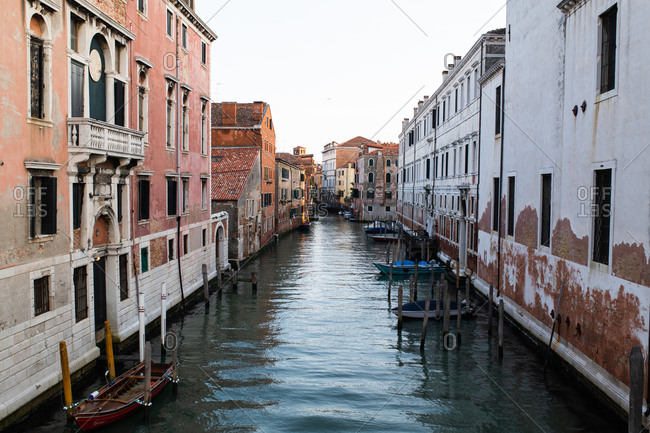 Venice, Italy - May 10, 2019: Old buildings lining a canal in Venice