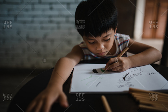 Young Asian boy drawing a picture