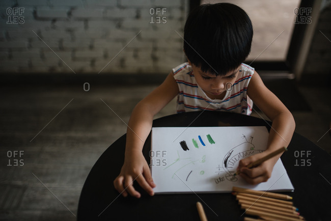 Asian boy drawing a picture