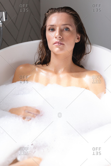 Close-up of beautiful woman bathing in the bathtub in bathroom