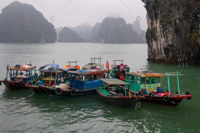 HALONG BAY, VIETNAM - JANUARY 2018: Fishing boats at the harbor