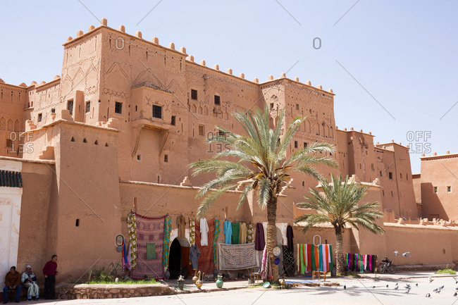 Ouarzazate, Morocco - April 12, 2019: Vendors resting in the shade of Taourirt Kasbah