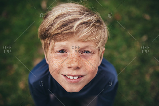 Portrait of a young boy outside in the early spring