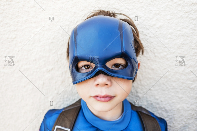 Portrait of a cute young boy wearing a super hero mask