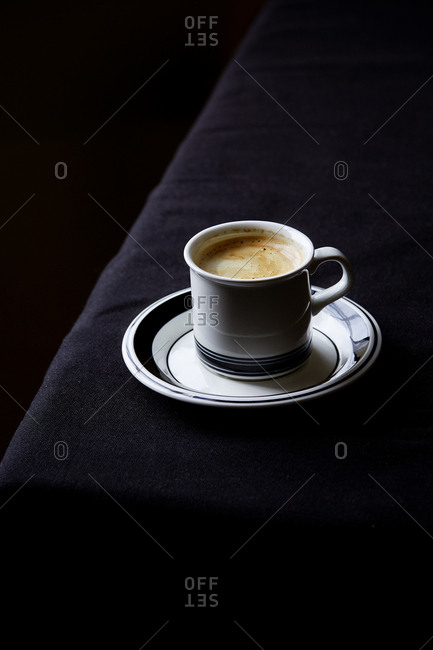 Single espresso on the edge of a table