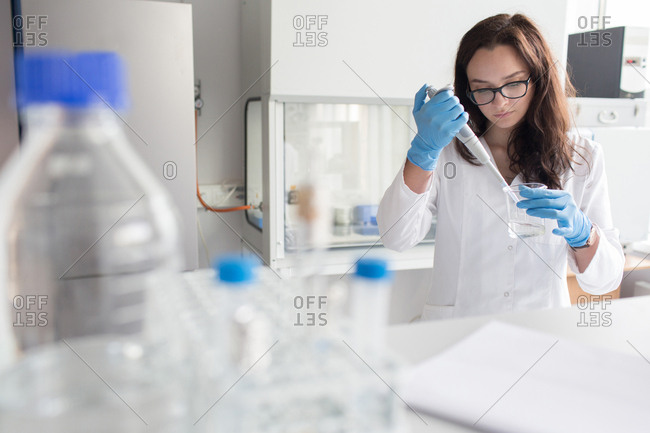 Woman holding flask in lab