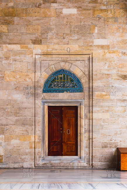 May 16, 2019: Beautiful wooden door in old historic mosque at Istanbul, Turkey