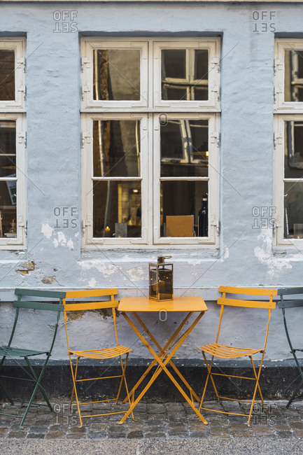 March 20, 2019: Denmark- Copenhagen- Tables infront of a pavement cafe