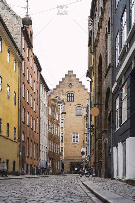Denmark- Copenhagen- Narrow alley with cobblestone pavement in the old town