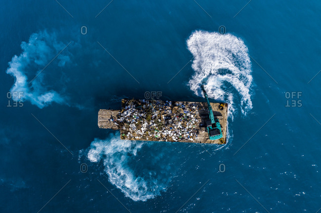 Maldives- South-Male-Atoll- plastic waste disposal with digger from above