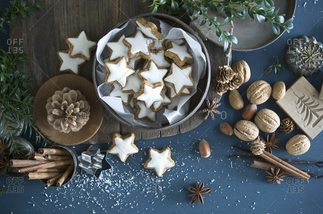 Cinnamon stars in tin can- star anise- cinnamon sticks- nutcracker and pine cones