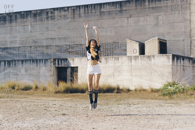 Spain- teenage girl jumping outdoors