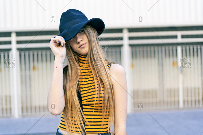 Portrait of teenage girl wearing hat and glasses