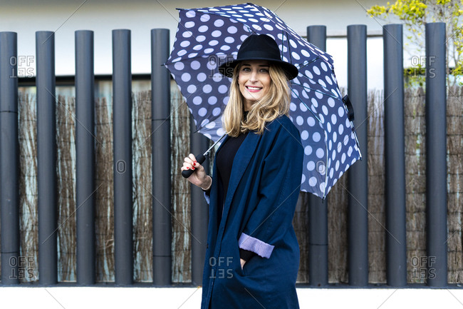 Blond woman with umbrella on a rainy day