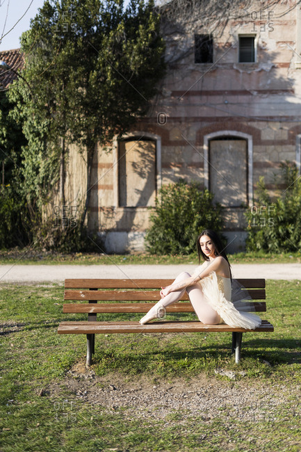 Italy- Verona- portrait of ballerina sitting on bench in the city