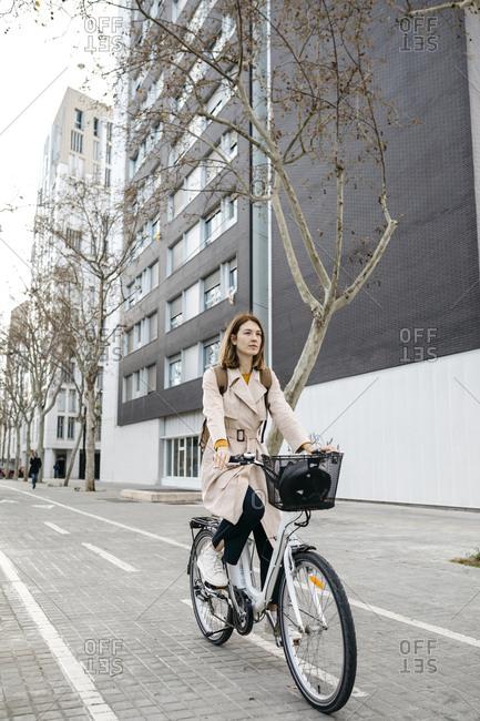 Woman riding e-bike in the city
