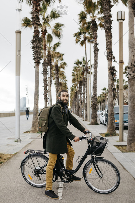 Portrait of man with e-bike on a promenade