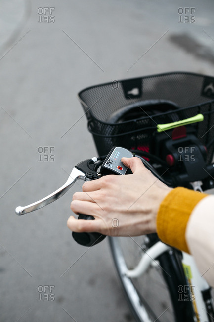 Close-up of woman on e-bike connecting the electric motor