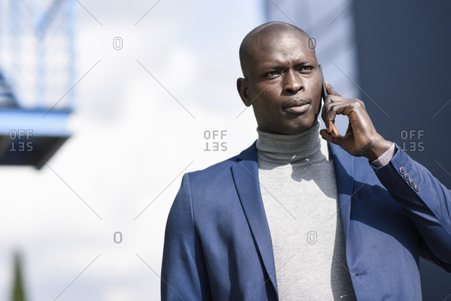 Portrait of businessman on the phone wearing blue suit