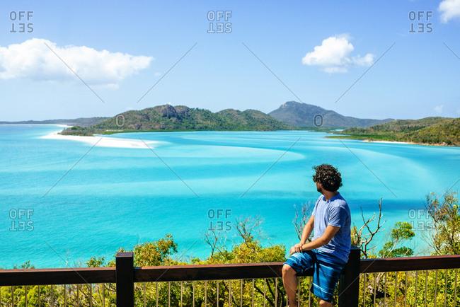 Australia- Queensland- Whitsunday Island- man looking at Whitehaven Beach