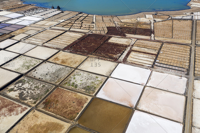 Spain- Canary Islands- Lanzarote- Yaiza- salt mining fields- aerial view
