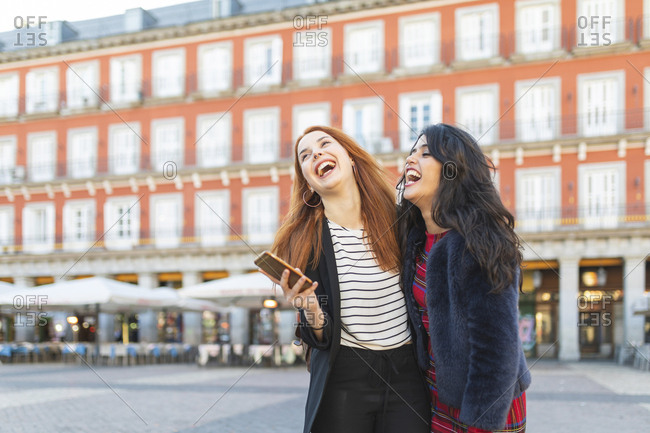 Spain- Madrid- Plaza Mayor- two best friends having fun together in the city