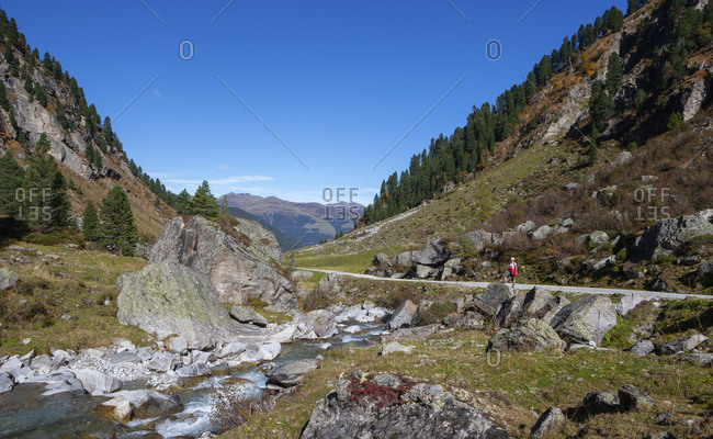Austria- Salzburg State- High Tauern National Park- Zillertal Alps- woman hiking on trail