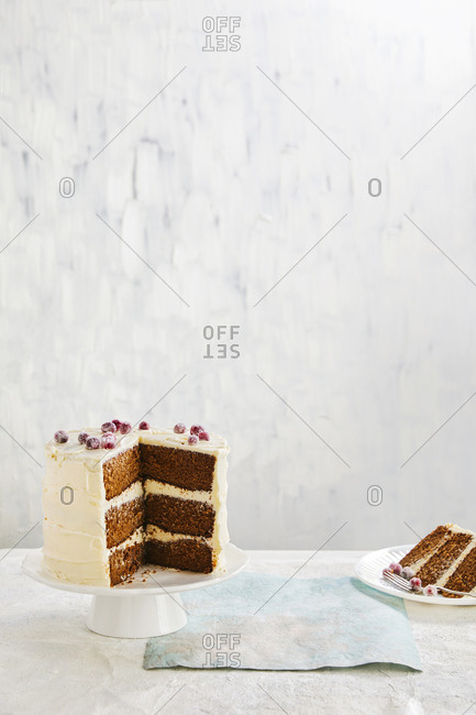 Carrot cake with vanilla frosting and berries
