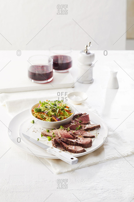 Steak served with broccoli salad