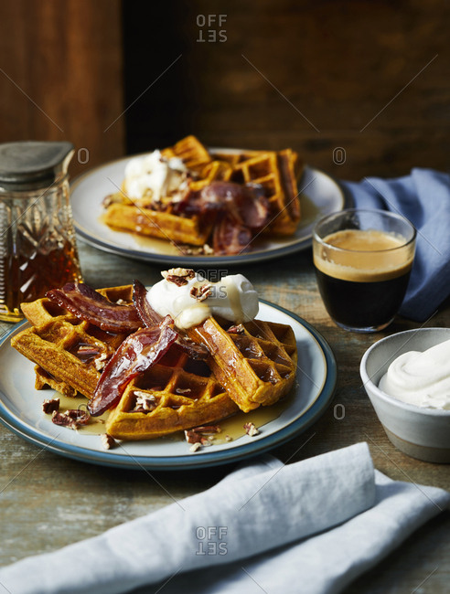 Spiced squash waffle with bacon and cream