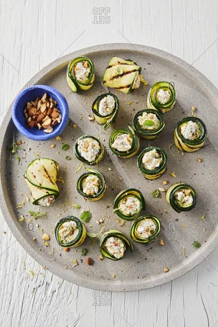 Plate of gorgonzola stuffed zucchini rolls
