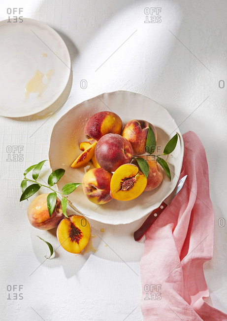 Bowl of ripe yellow peaches