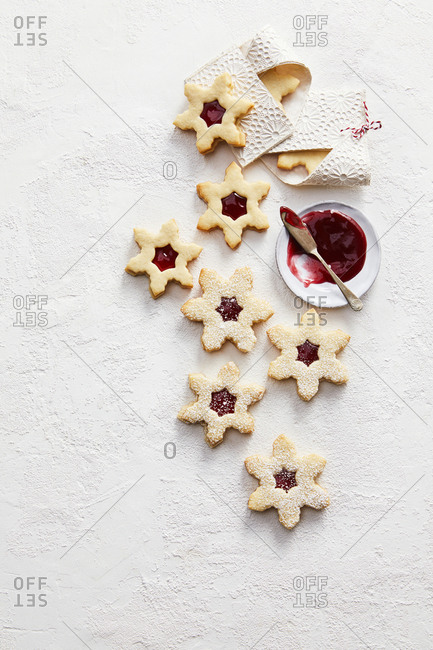 Overhead view of peekaboo jam star cookies shaped like snow flakes