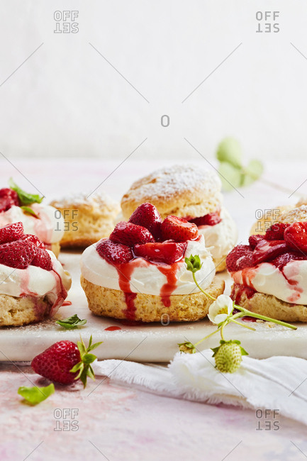 Detail of strawberry shortcakes on a white plate