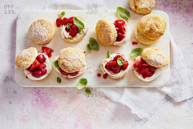 Overhead view of a tray of  prepared strawberry shortcake
