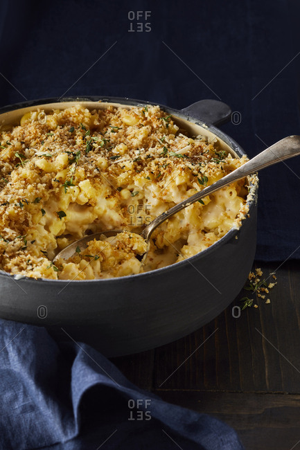 Large serving bowl of  macaroni and cheese with breadcrumb and herb crust