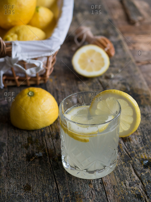 From above closeup glass cup with delicious fresh lemon drink