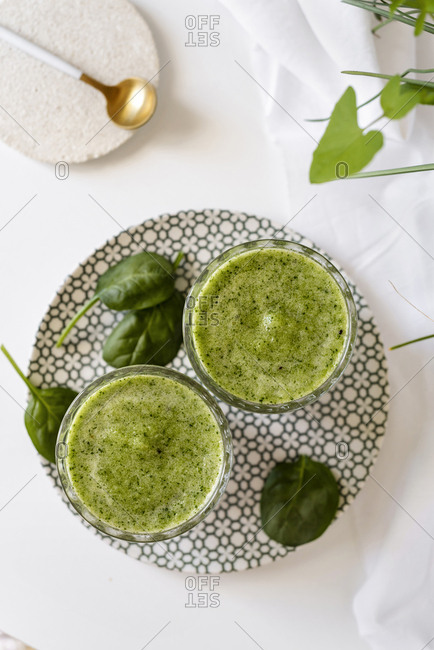 Healthy green smoothie - spinach, avocado and kiwi apple with lemon juice ,. Super food, detox and healthy food. From above