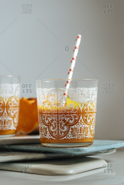 Mango and pumping smoothie on a glass. Surrounded by fruits and vegetables, healthy life concept