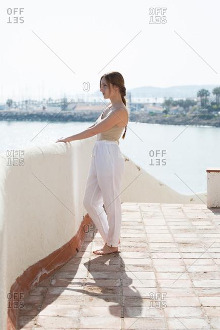 Sensual woman walking on embankment