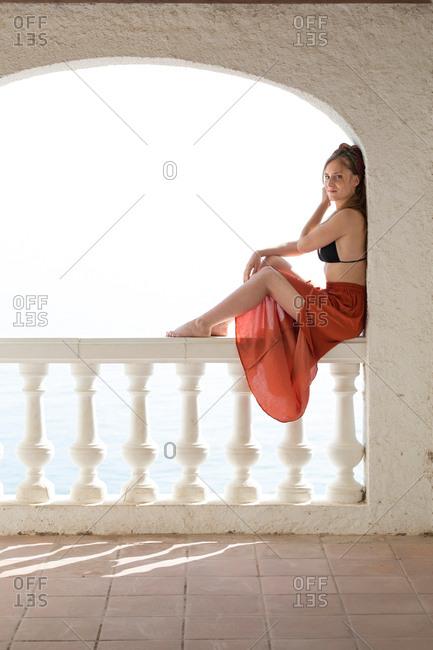 Sensual lady relaxing near sea