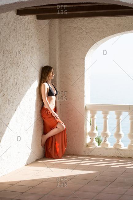 Sensual lady standing near sea