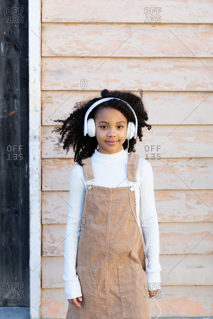 African-American girl listening music with headphones